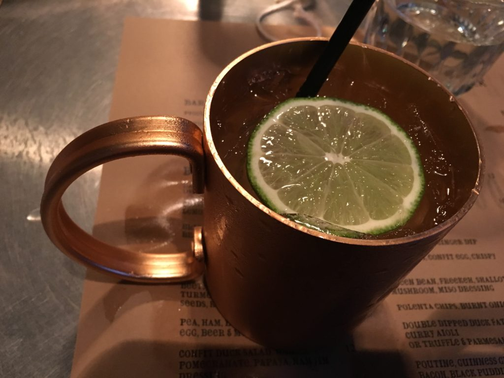 vodka and ginger beer in moscow mule cup at cleaver restaurant calgary
